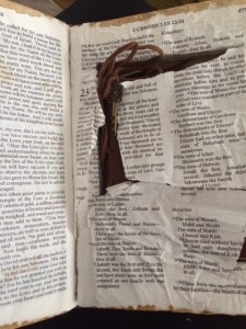 Bible ripped open to reveal the hidden diary.